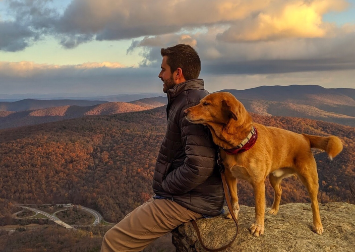 Man and dog on mountain